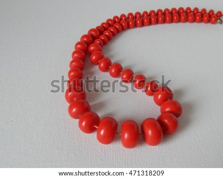 red beads isolated on a white background