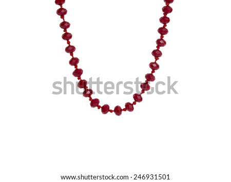 Red beads necklace isolated on white background - stock photo