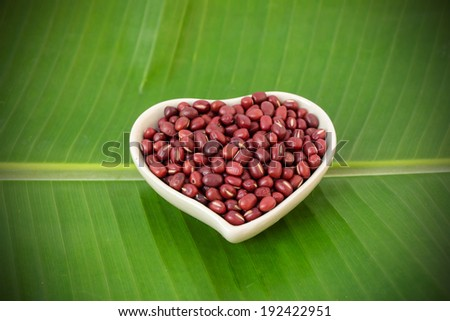 Red bean on banana green leave background - stock photo