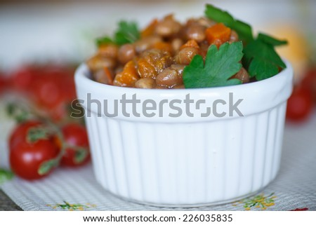 red bean stew with carrots, tomatoes and vegetables - stock photo