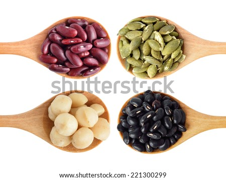 Red beans, black beans, pumpkin seeds and macadamia isolated on white - stock photo