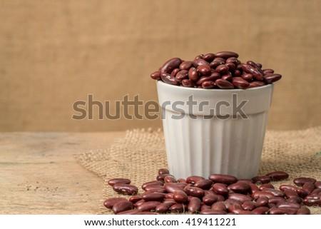 Red beans in white ceramic bowl - stock photo