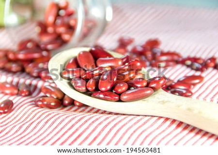 red beans on red table cloth - stock photo