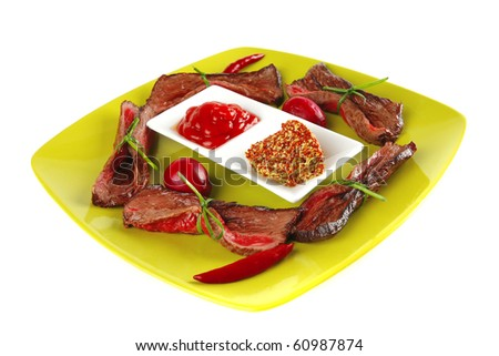 red beef curved meat slices on green - stock photo