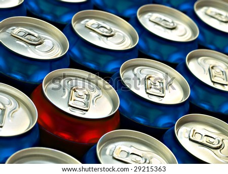 Red beer can standing out from the crowd of Blue beer cans - stock photo
