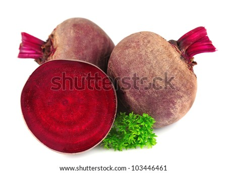 red beets with parsley leafs on white background - stock photo