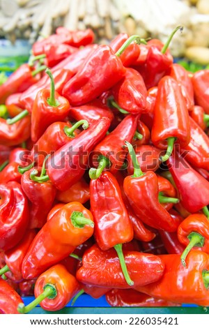 Red bell peppers at the local farmer's market.  - stock photo