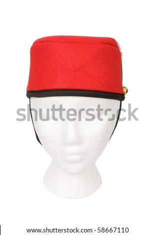 Red bellhop hat isolated on white. Resting on a model head for proper perspective. Contains a clipping path for easy extraction. - stock photo