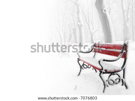 Red benches in the fog in winter with space for text - stock photo