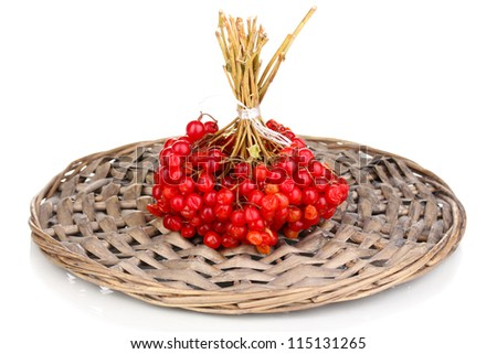 red berries of viburnum on wicker mat isolated on white - stock photo