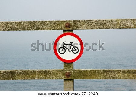 "Red ""Bicycle"" sign on the wooden rails"