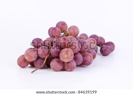 red big fresh grapes on white background - stock photo