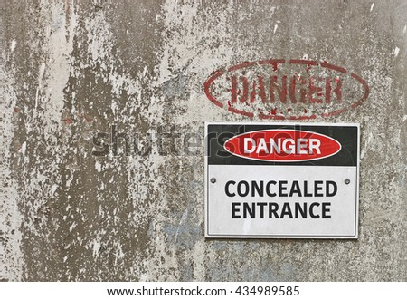 red, black and white Danger, Concealed Entrance warning sign - stock photo