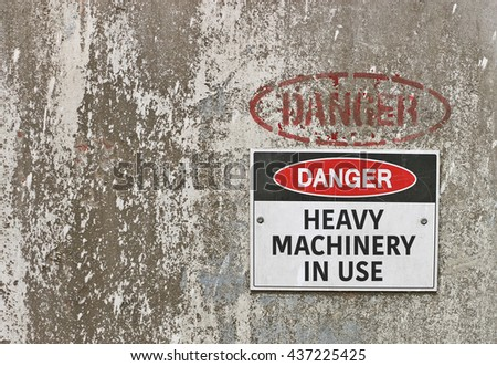 red, black and white Danger, Heavy Machinery In Use warning sign - stock photo