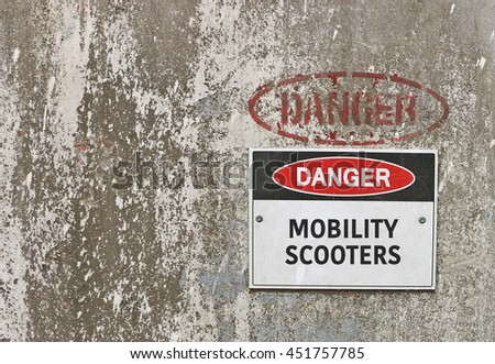 red, black and white Danger, Mobility Scooters warning sign - stock photo