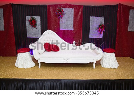 Red & Black themed Indian wedding stage - stock photo