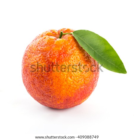 red blood orange with green leaves isolated on white background.