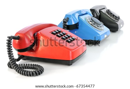 Red, blue and black phones on a white background - stock photo