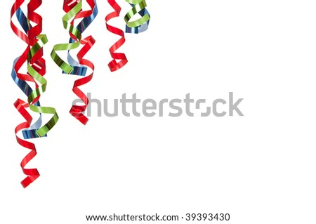 red, blue and green curly ribbons on white background with copy space