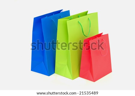 red, blue and green holidays paper-bags for packing presents isolated on white - stock photo
