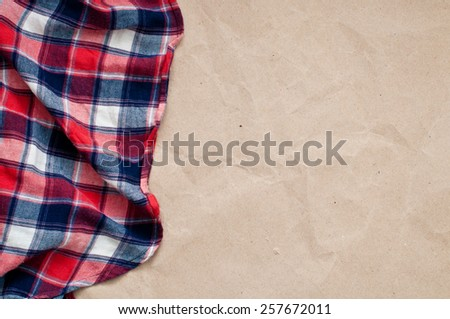 Red blue checked shirt and craft paper background - stock photo