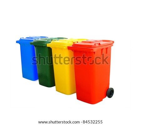 Red blue green and yellow recycle bins isolated - stock photo