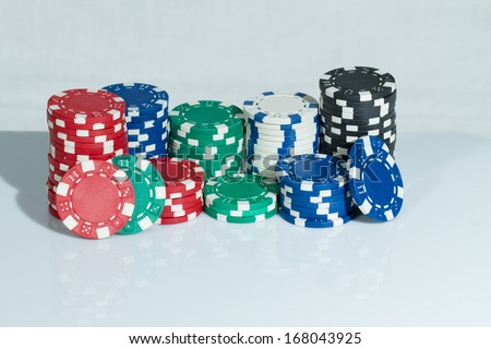 Red, blue, green, black and white Playing Poker Chips
