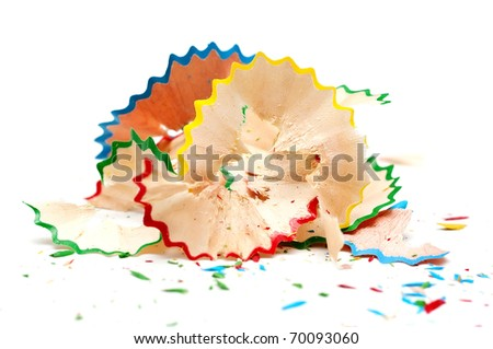 red, blue,  yellow and green pencil shaving on white background - stock photo