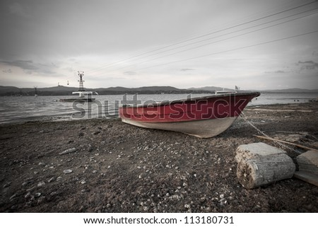 red boat and black and white background