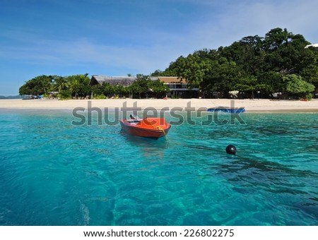 red boat and tropical sea, beach. - stock photo