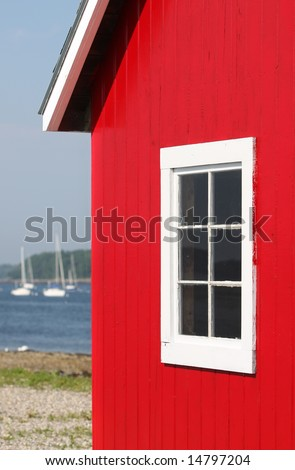 Red Boat House On Maine Bay - stock photo