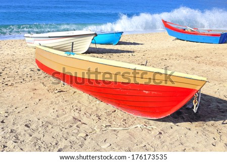 red boat on beach - stock photo