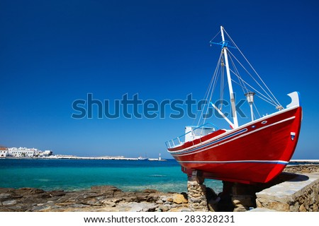 Red boat on island of Mykonos, Greece - stock photo
