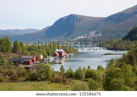 Red boathouses along a fjord in Norway (More og Romsdal) - stock photo