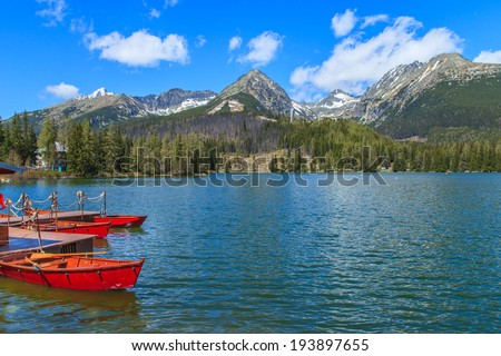 Red boats in a wooden port in Strbske Lake in Strbske Pleso, Slovakia