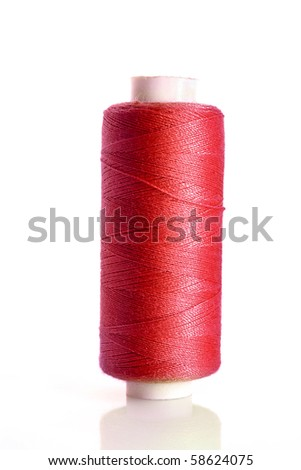 red bobbin thread isolated on white - stock photo