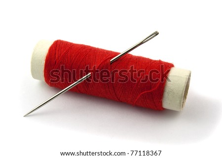 Red Bobbin with needle isolated on white