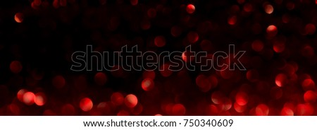 red bokeh abstract background with defocused lights