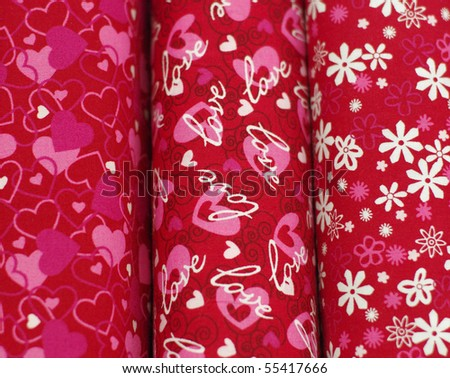 Red bolts of fabric for sewing - stock photo