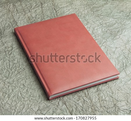 red  book in leather cover on a design paper, identity design, corporate templates, company style