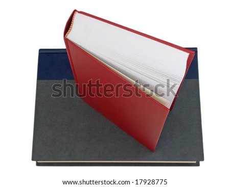 Red book on gray book - stock photo