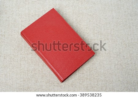 Red book on the sofa - stock photo