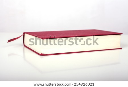 Red Book on white background - stock photo