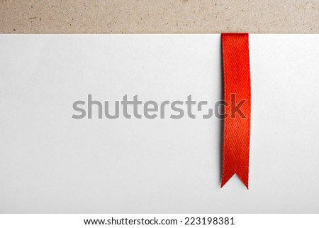 Red bookmark on empty sheet of paper