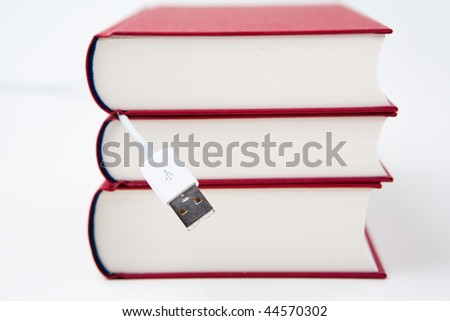 red books with white usb cable
