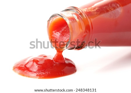 red bottle of Tomato Ketchup on white background - stock photo