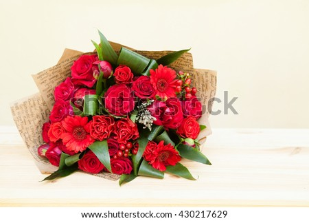Red bouquet of roses, gerberas, peonies, pomegranates with copyspace. Love and passion symbol. Anniversary gift. Birthday gift for girl. - stock photo