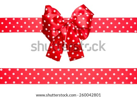 red bow and ribbon with white polka dots made from silk isolated - stock photo