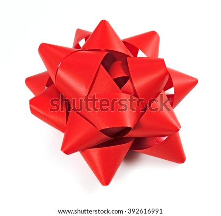 Red bow, high angle shot. Isolated on white.