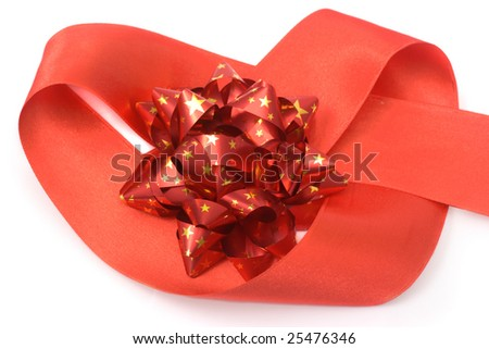 Red bow in a heart of red ribbon isolated on white